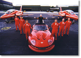 Red Arrows team with Marcos car